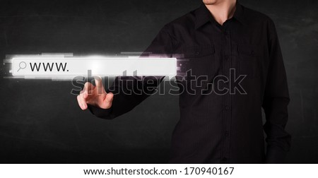 Young man touching web browser address bar with www sign  - stock photo