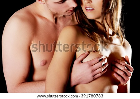 Young man touching woman's breast. - stock photo