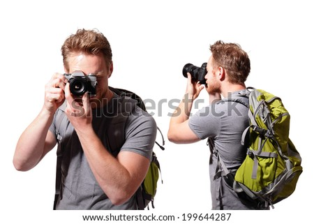 young man tourist use camera with backpack isolated on a white background, caucasian - stock photo