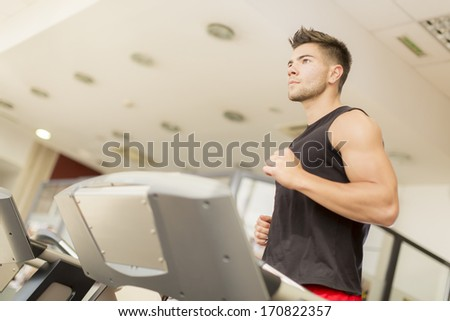 Young man training in the gym - stock photo
