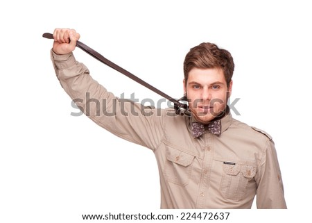 Young man trying to stifle himself with belt, isolated on white. Concept for work annoyance - stock photo