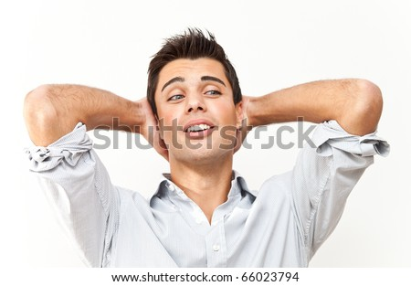 Young man unhappy bringing hands on his head - stock photo