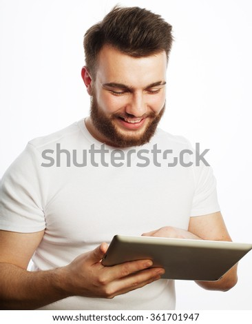 young man  using a tablet computer  - stock photo