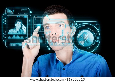 Young Man Using A Virtual Touchscreen Computer Interface With Cloud Data To Compute Analytics And Utilise Global Connections - stock photo