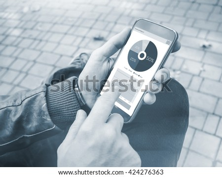 Young Man using smartphone with finance report charts on screen. Business Research - stock photo