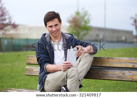 young man using tablet - stock photo