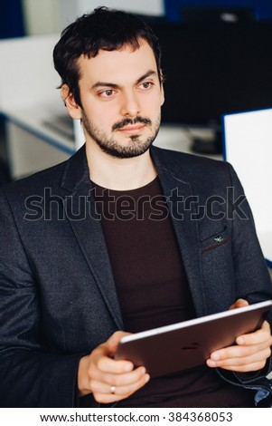 Young man using tablet in office - stock photo