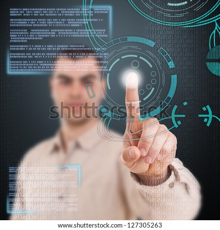 Young man using technologies of the future - stock photo