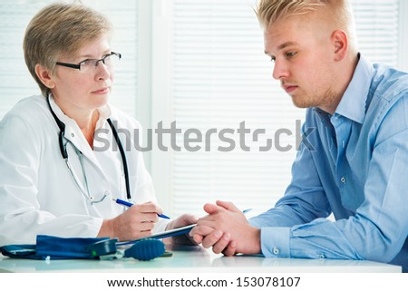 Young man visits doctors office suffering with depression - stock photo