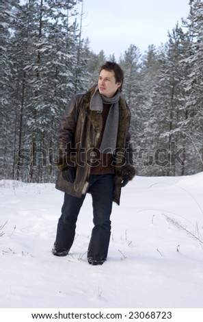 young man walking in forest - stock photo