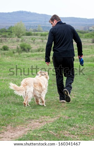 Young man walking with your dog  - stock photo