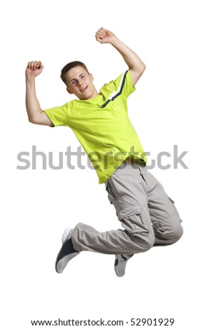 Young man wearied in green sports shirt jumping, isolated on white - stock photo