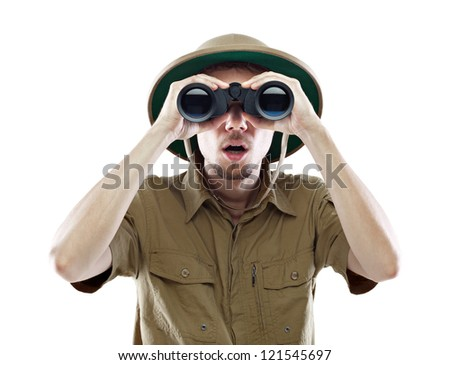Young man wearing a pith helmet looking through a pair of binoculars with a surprised expression, isolated on white - stock photo