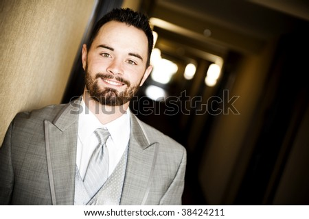 Young man wearing a suit - stock photo