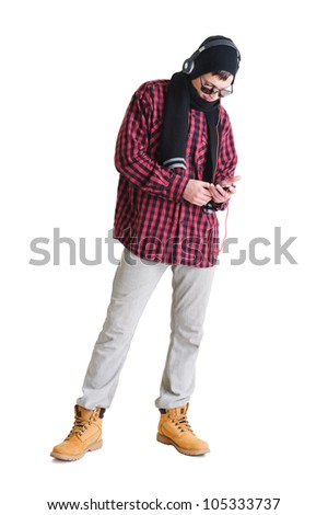 young man wearing casual dress with phone and headphones - stock photo