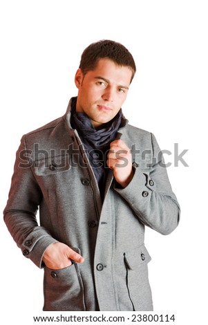 Young man wearing coat and scarf isolated on white - stock photo