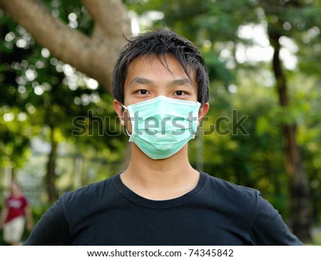 young man wearing face mask - stock photo