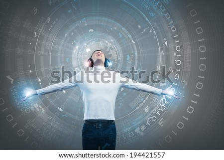 Young man wearing headphones against media background. New technologies - stock photo