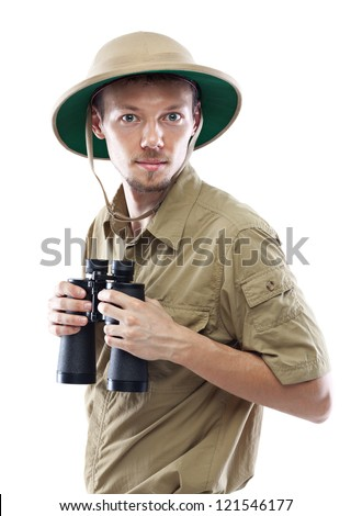 Young man wearing safari shirt and pith helmet holding binoculars, isolated on white background - stock photo