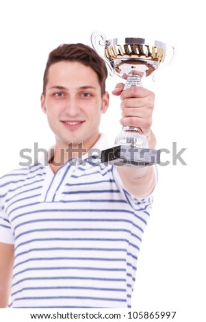 young man winning the first place trophy at a competition, on white background - stock photo