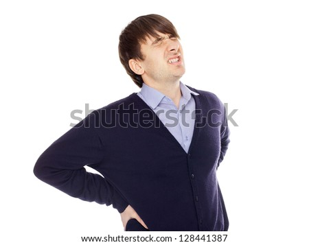 Young man with a backache isolated on white background - stock photo