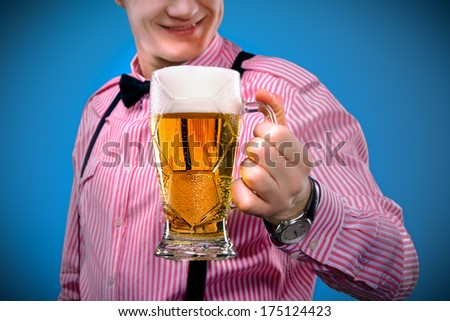 Young man with a beer - stock photo