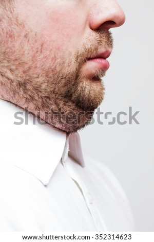 young man with a double chin - the result of poor lifestyle - stock photo