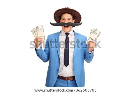 Young man with a fake moustache and a cowboy hat holding few stacks of money isolated on white background - stock photo