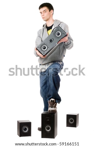 Young man with a four speakers. Isolated - stock photo