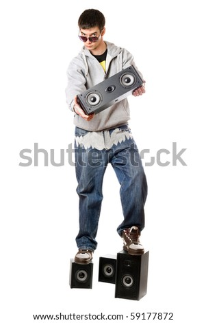 Young man with a four speakers. Isolated on white - stock photo