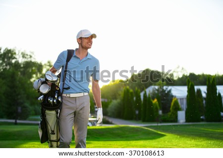 Young man with a golf bag - stock photo
