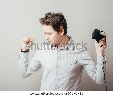 young man with a joystick - stock photo