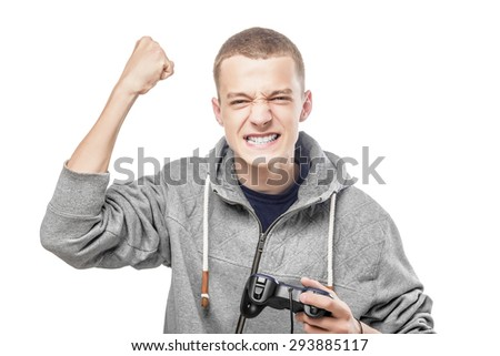 Young man with a joystick for game console celebrating success. Isolated on white. - stock photo
