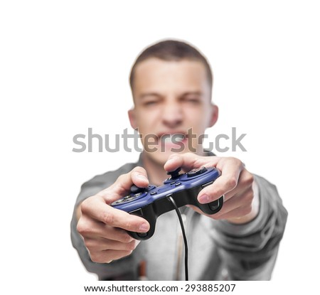 Young man with a joystick for game console. Focus on joystick. Isolated on white. - stock photo