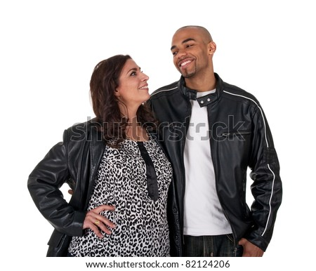 Young man with a mature woman, smiling and looking at each other. - stock photo