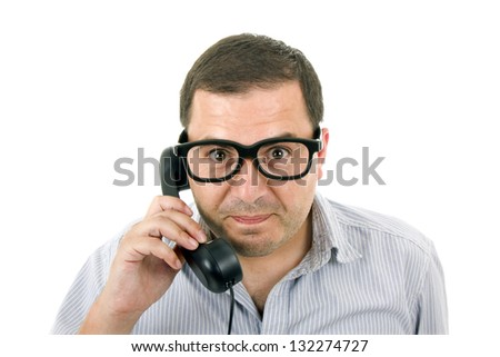 young man with a phone and glasses, isolated on white - stock photo