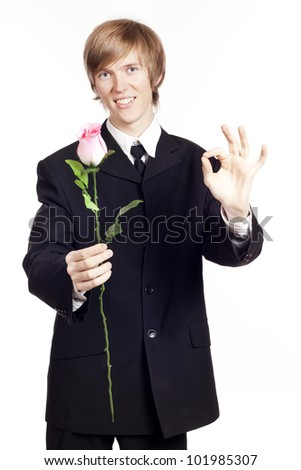 Young man with a rose showing hand ok sign - stock photo