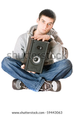 Young man with a speaker in his hands. Isolated - stock photo