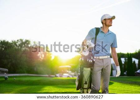 Young man with a stick outdoors - stock photo