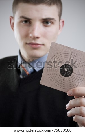 Young man with a target in hand - stock photo