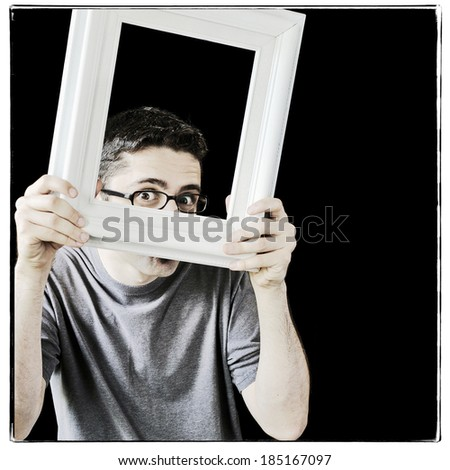 Young man with a vintage white picture frame, instagram style - stock photo