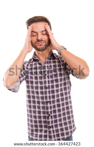 Young man with an headache, isolated over white - stock photo