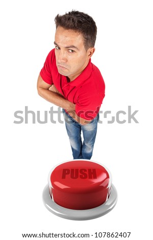 young man with arms crossed on top of a red button - stock photo