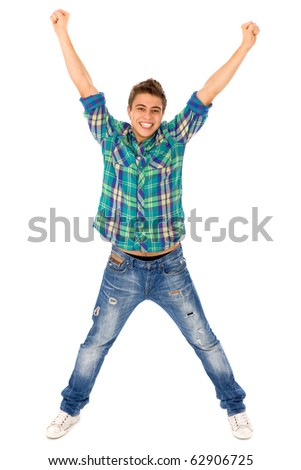 Young man with arms raised - stock photo