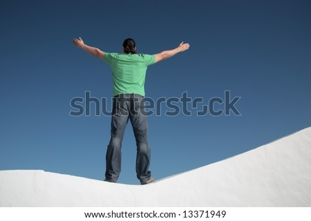 young man with arms wide open - stock photo