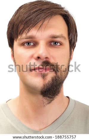 Young man with  beard on half of the face on white background - stock photo