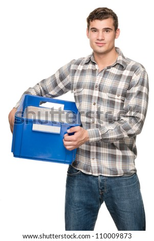 Young man with blue box in front of white background - stock photo