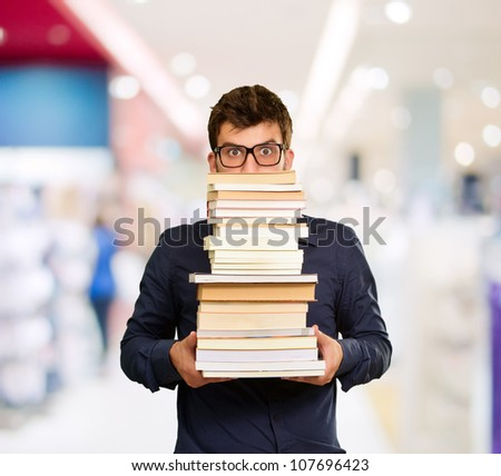 Young Man With Books, Indoor - stock photo