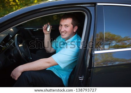 young man with car - stock photo