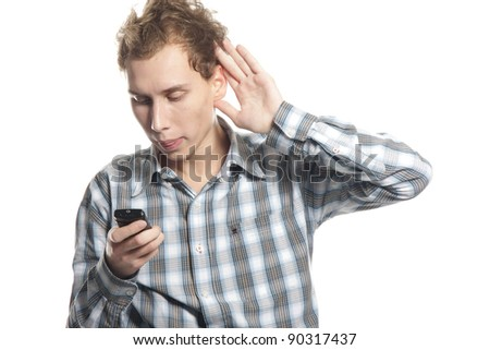 young man with cell phone over white - stock photo